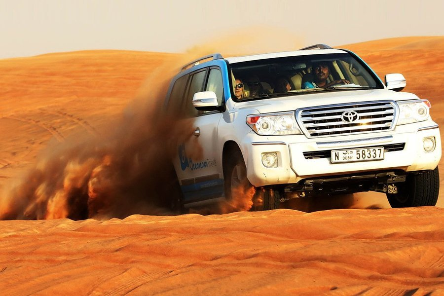 Evening Desert Safari Tour with BBQ Dinner: Dune Bashing, Camel Riding & More - Tour